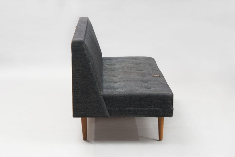 Three-seat sofa with oak legs. This piece is in original condition, can be sold as it is or fully restored, the price shown is in original condition.