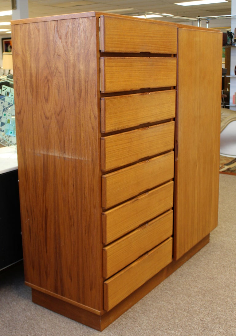 For your consideration is a wonderful, teak dresser, with ten drawers, made in Denmark, circa 1960s. In very good vintage condition, with a break in the wood near a hinge. The dimensions are 49