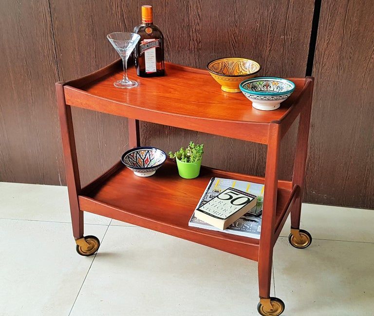 Mid-Century Modern teak bar cart trolley, Denmark, 1960s. Brass castors.