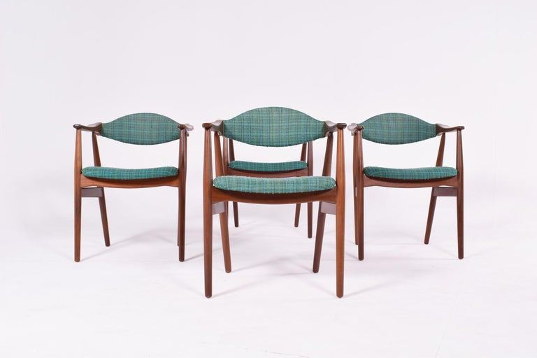 Set of 4 armchairs in teak. Original wrapper with fabric upholstery on seat and back. Made in Denmark.