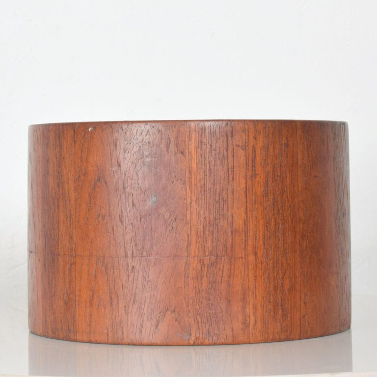 For your pleasure: Dansk teak ice bucket Mid-Century Modern. Dansk International Malaysia.  Features matching lid and plastic waterproof interior.   Item is original vintage unrestored condition. Gently used. Refer to images