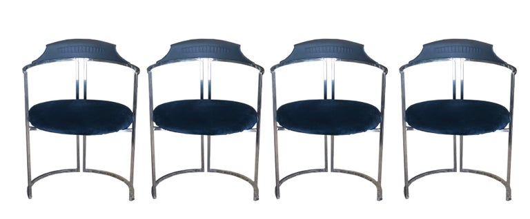 Dining set of four midcentury original Daystrom chairs with original white melamine table top with chrome base. The chairs are chrome and have a decorative back panel decoration that is original and in great shape. The upholstery is new and in