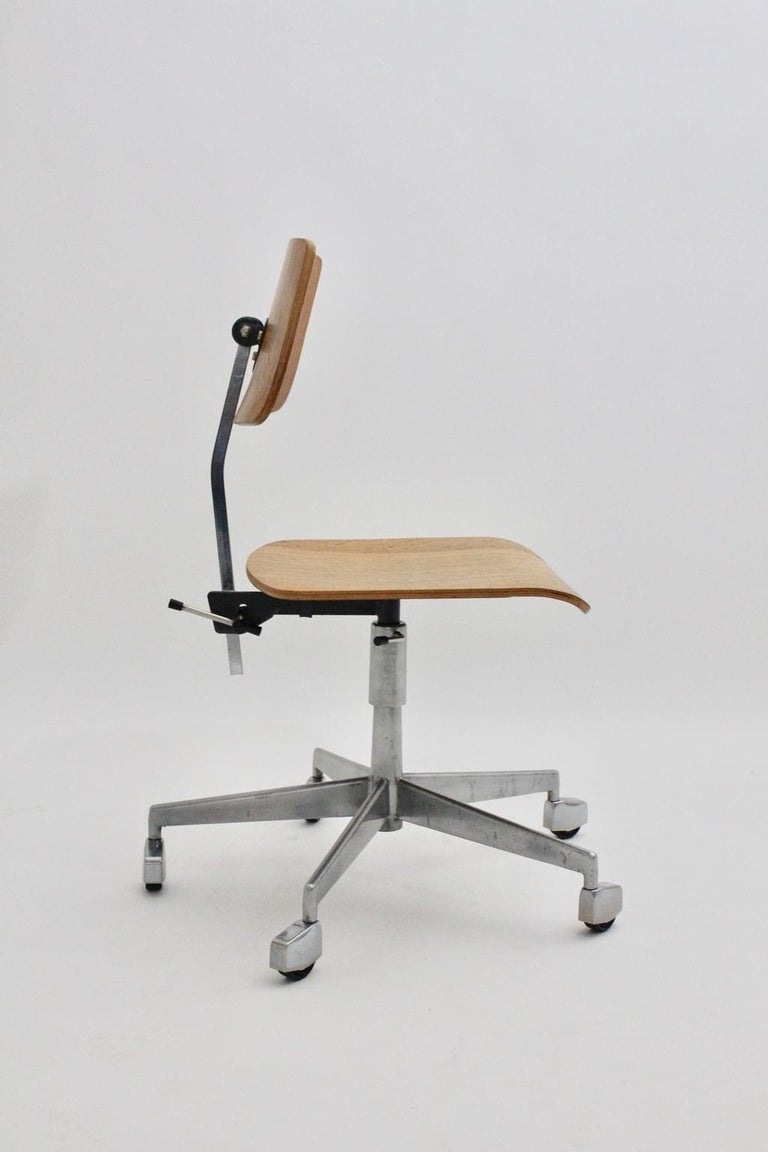 The swivelling desk chair was designed by Jorgen Rasmussen circa 1950 Denmark and executed by Labofa (marked). The seat is adjustable from up to down and features a swivelling function also the backrest is adjustable from up to down. The chair was