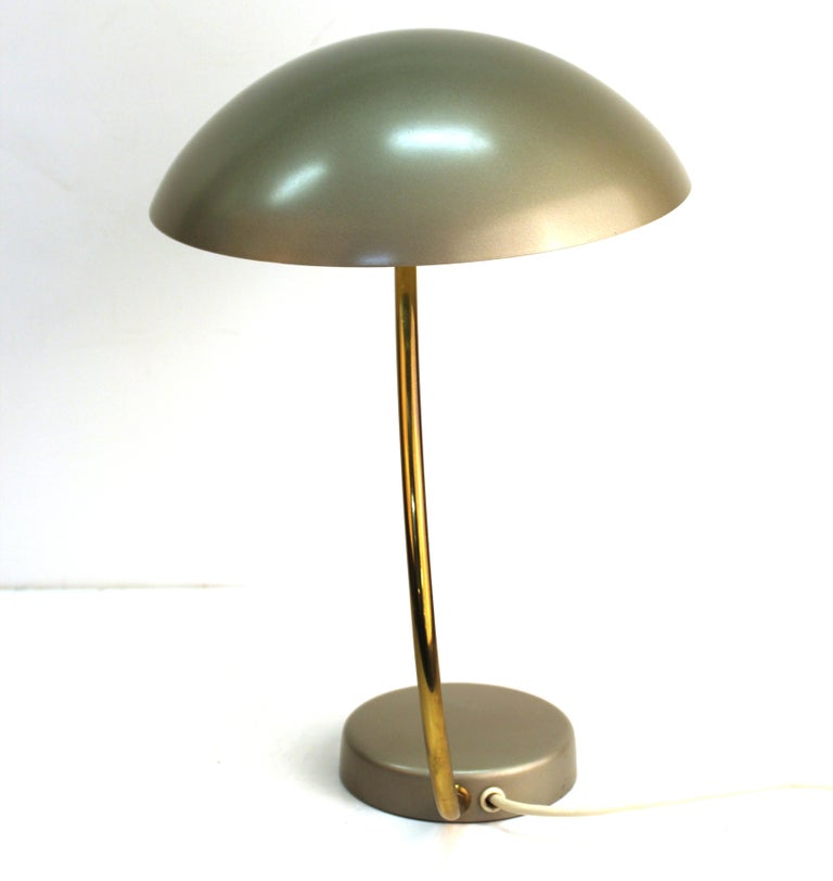 Mid-Century Modern metal saucer desk lamp with brass stem. The piece was likely made in Germany during the mid-20th century and is in great vintage condition with age-appropriate wear.