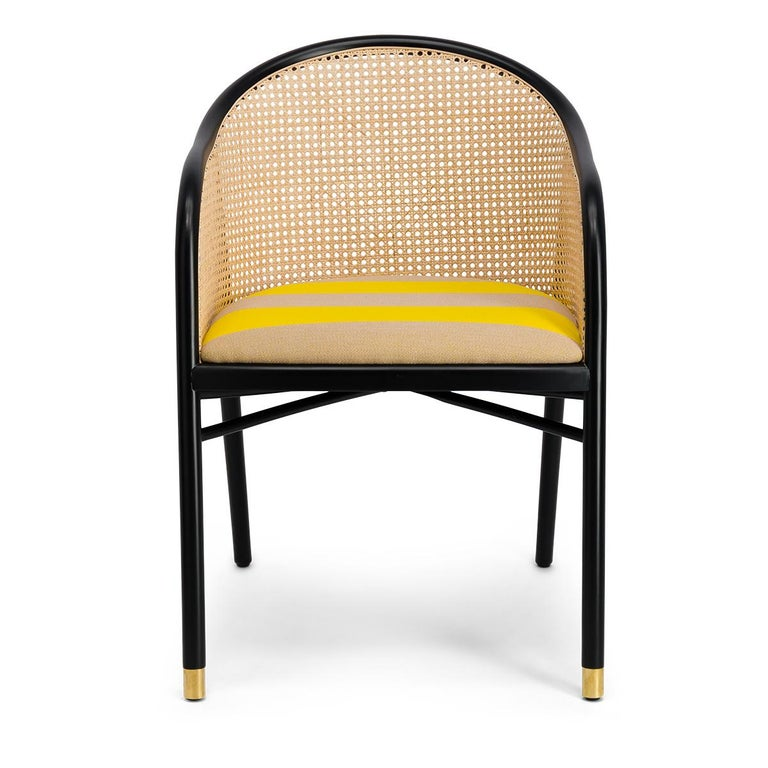 A set of 6 elegantly, handcrafted dining chairs in black lacquer finish with a seat upholstered in yellow \\\