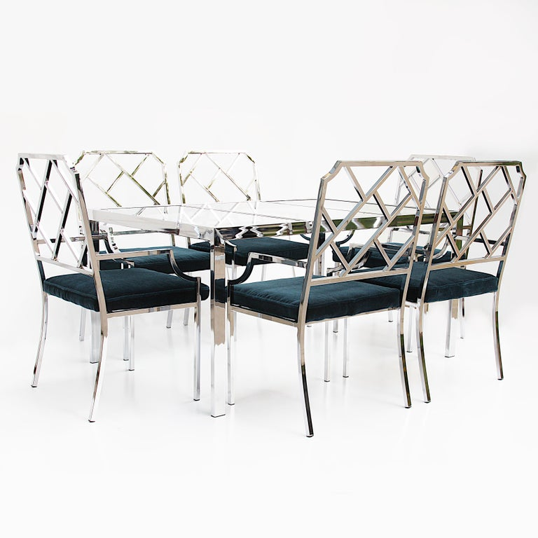 Wonderful set of 6 Chinese Chippendale chairs and matching table designed by Milo Baughman for Design Institute of America (DIA). Set features six matching chrome armchairs with a modern, Asian motif and a matching minimalist chrome table that