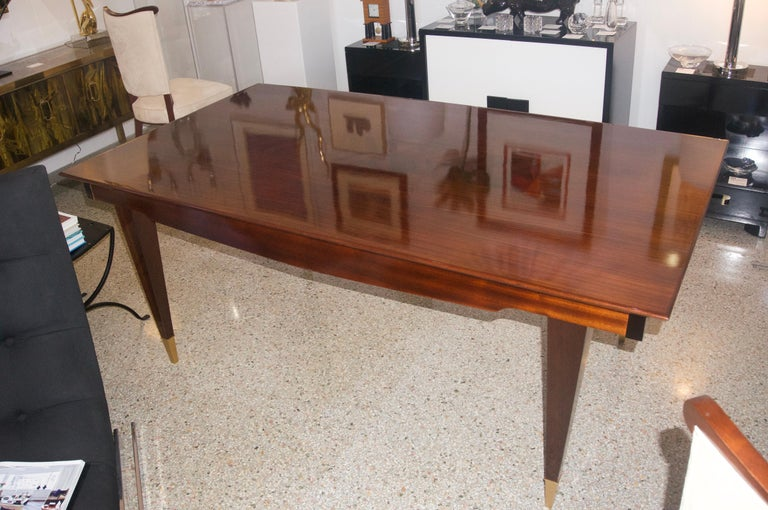 This stylish and chic dining table is very much in the style of pieces created by the Italian, furniture designer Paolo Buffa. The piece has been professionally refinished and restored. The restoration included the addition of two extension leaves