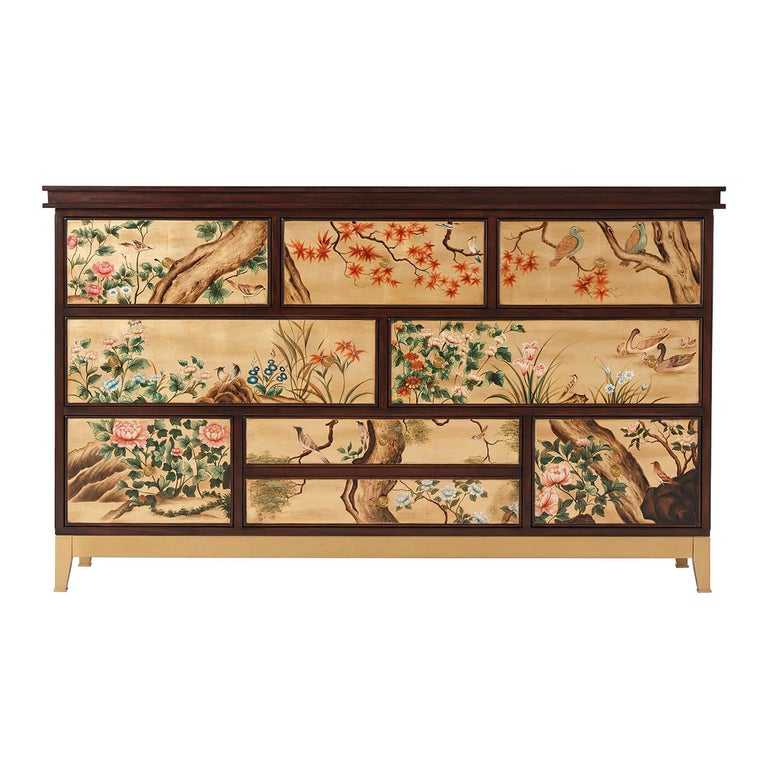 A Mid-Century Modern style dresser with inspiration from 18th century chinoiserie decorated European furniture. The dresser with a figured mahogany rectangular top and case with eight hand painted gilt and chinoiserie decorated drawers on tapered
