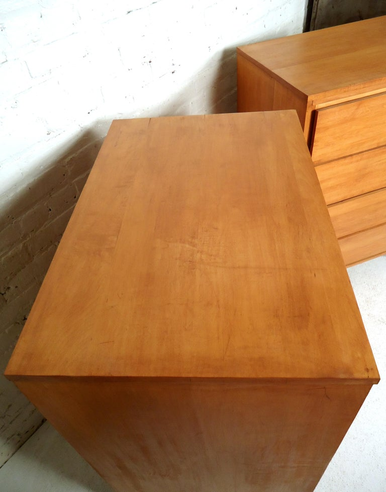 Gorgeous Mid-Century Modern high boy dresser featuring maple wood grain, four drawers, with a uniquely designed front base.  (Please confirm item location - NY or NJ - with dealer).