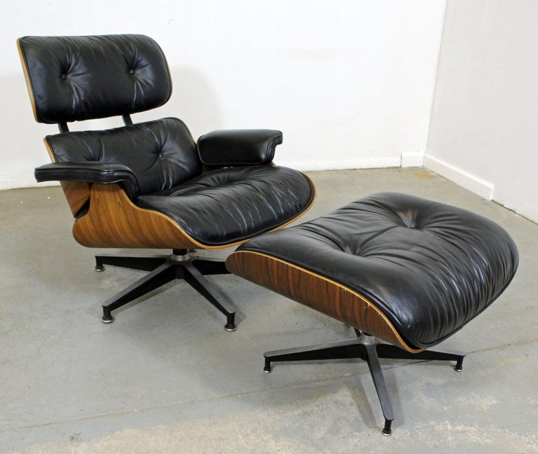 What a find. Offered is later model lounge chair and ottoman by Eames for Herman Miller, 670 & 671. It is in decent condition, but has noticeable age wear (small tears in seat, ottoman missing a button, wear on brushed aluminum legs, small chip on