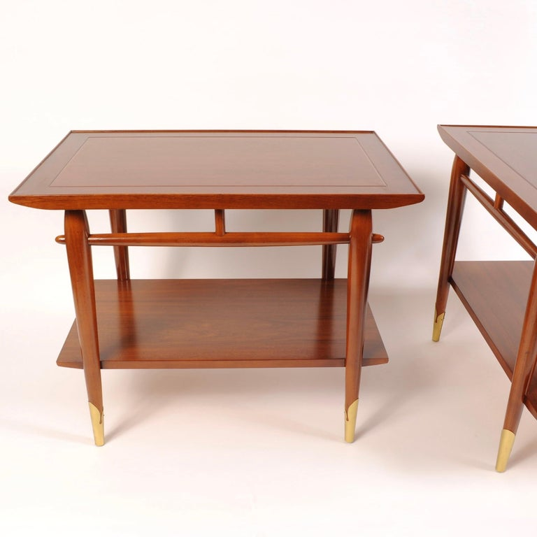 1960s era walnut end tables featuring lower shelves and sculptured legs with brass end caps. As clean a set as you could expect after 55+ years.