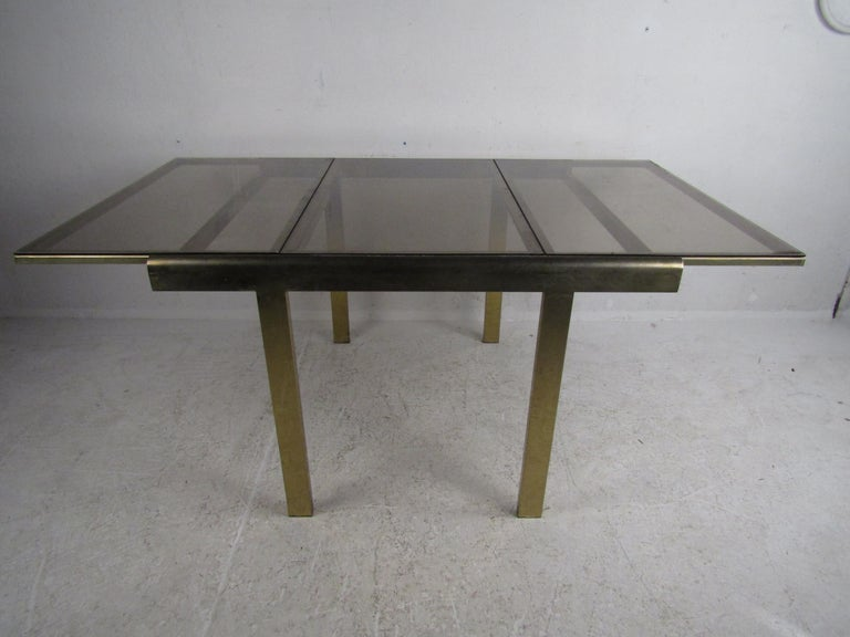 Mid-Century Modern Expanding Brass Dining Table with a Smoked Glass Top In Good Condition For Sale In Brooklyn, NY