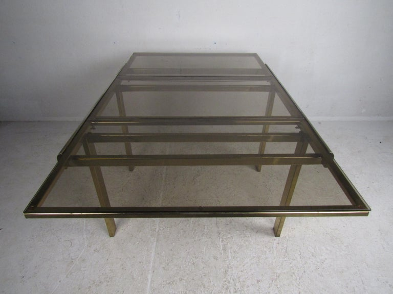 20th Century Mid-Century Modern Expanding Brass Dining Table with a Smoked Glass Top For Sale