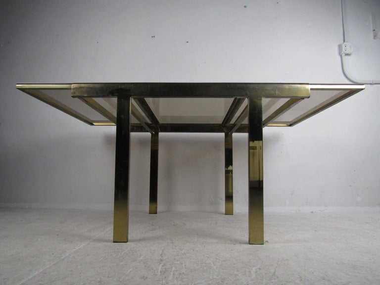 Mid-Century Modern Expanding Brass Dining Table with a Smoked Glass Top For Sale 1