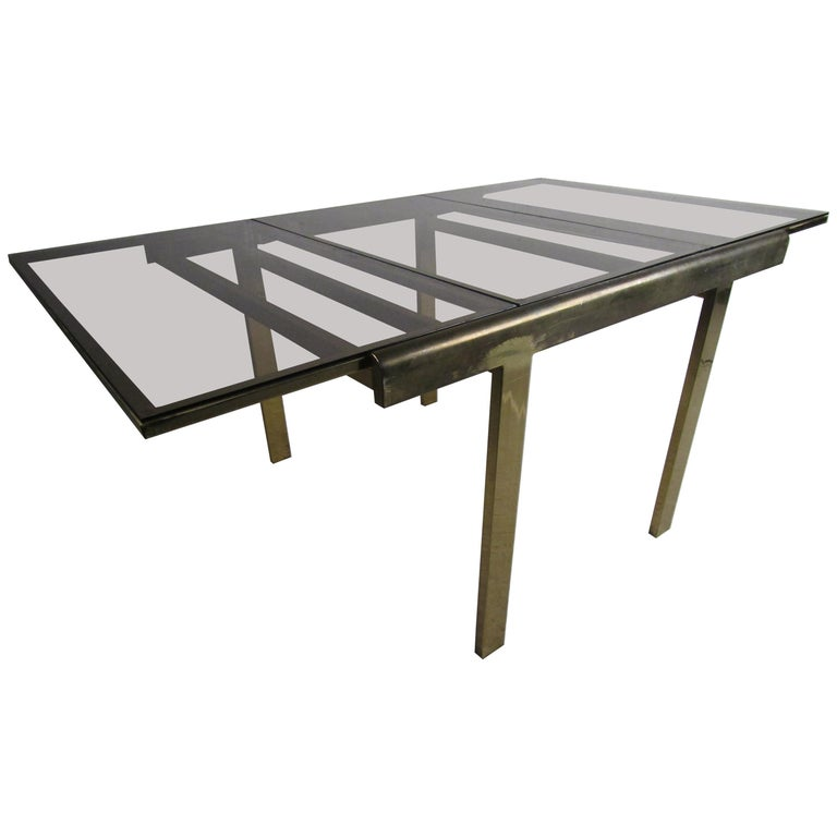 Mid-Century Modern Expanding Brass Dining Table with a Smoked Glass Top For Sale