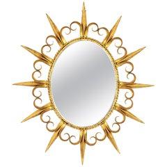 Mid-Century Modern Fleur-de-Lys Gilt Iron Sunsburst Mirror, Spain, 1960s