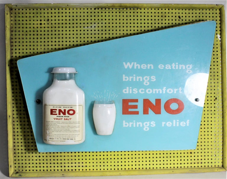 This advertising sign was made during the 1960s in the Mid-Century Modern style and likely originates from South Africa. The sign is a combination of a professionally made molded, and silk screened plastic advertisement, which has been crudely