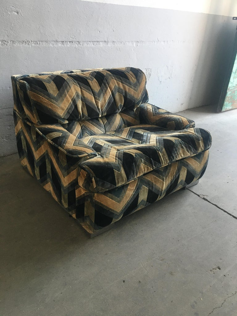Mid-Century Modern French armchair with original velvet fabric by Gérard Guermonprez, 1970s This armchair could be sold as a set together with its sofa (See picture attached). Price on demand.
