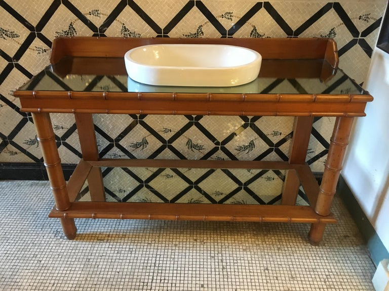 Mid-Century Modern French faux bamboo cupboard sink with mirror top, 1920s. This piece was a faux bamboo console converted into sink.