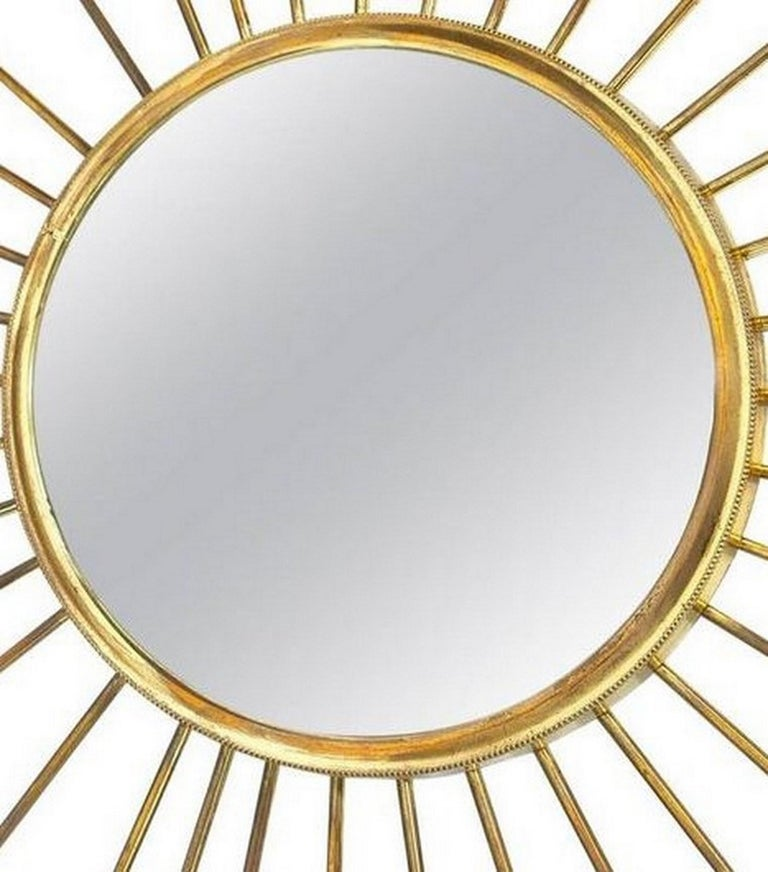 French brass sunburst mirror or 'mirror soleil' with convex mirror.