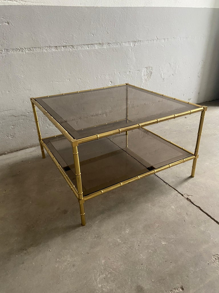 Mid-Century Modern French two-tier coffee or sofa table in faux bamboo brass with mirrored edges smoked glasses ledges by Maison Baguès.