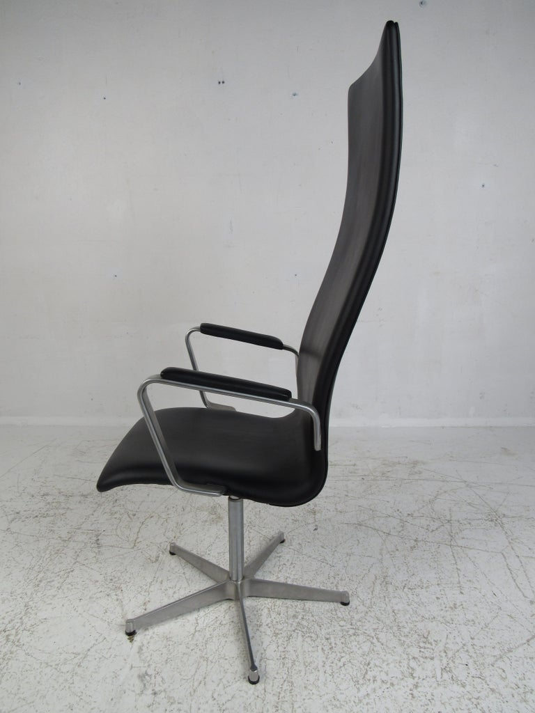 This stunning vintage modern desk chair boasts a tag underneath with the date 1980 and designer name,