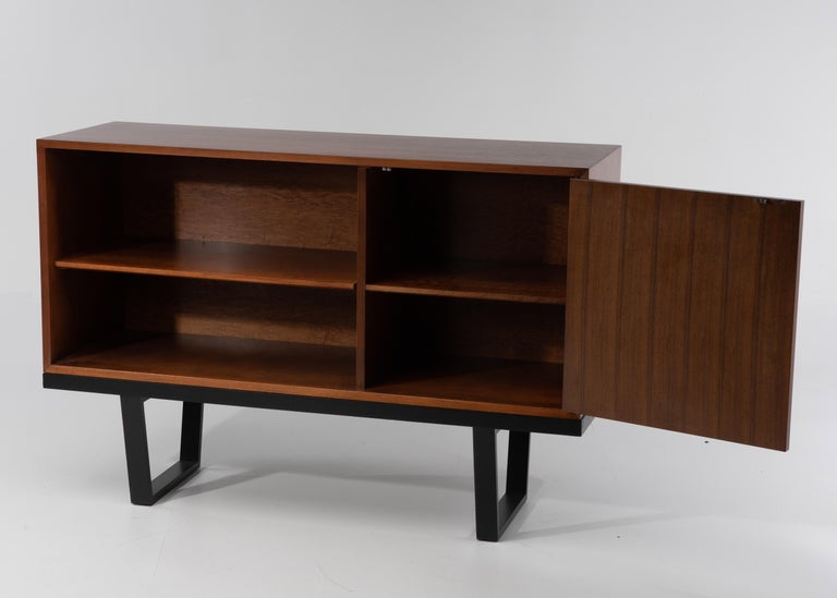 Vintage Mid-Century Modern oak cabinet by renowned designer George Nelson for Herman Miller. Base is a Classic ebonized slat bench, the open bookcase has an adjustable shelf, and the left side cabinet has a door and additional adjustable shelf.
