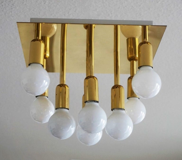 Mid-Century Modern gilt brass eight-light flush mount by Sölken Leuchten, Germany, 1960-1969. This elegant ceiling lamp is in very good condition, it has been hand polished and rewired. Measures: Width/depth 12