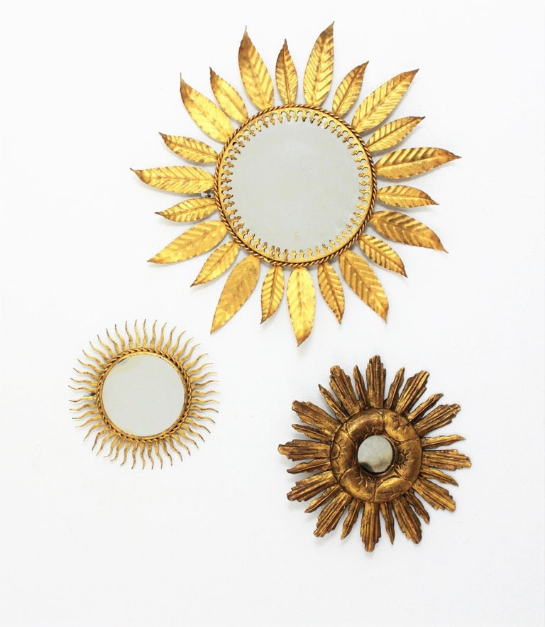 Small size hand-hammered gilt iron sunburst mirror. Spain, 1960s. This lovely mirror has a beautiful aged patina according to its age and it is an interesting piece to create a wall decoration combined with other sunburst mirrors in different sizes,