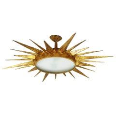 Mid-Century Modern Gilt Iron Sunburst Ceiling Light Fixture and Sunburst Mirror