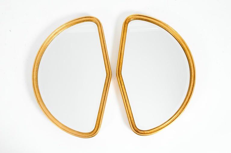 Mid-Century Modern giltwood frame with geometric shape hanging pair wall mirror. Each mirror is in great condition with appropriate wear consistent with age / use. Each mirror measure about 25 inches long x 16 inches wide x 2 inches deep.