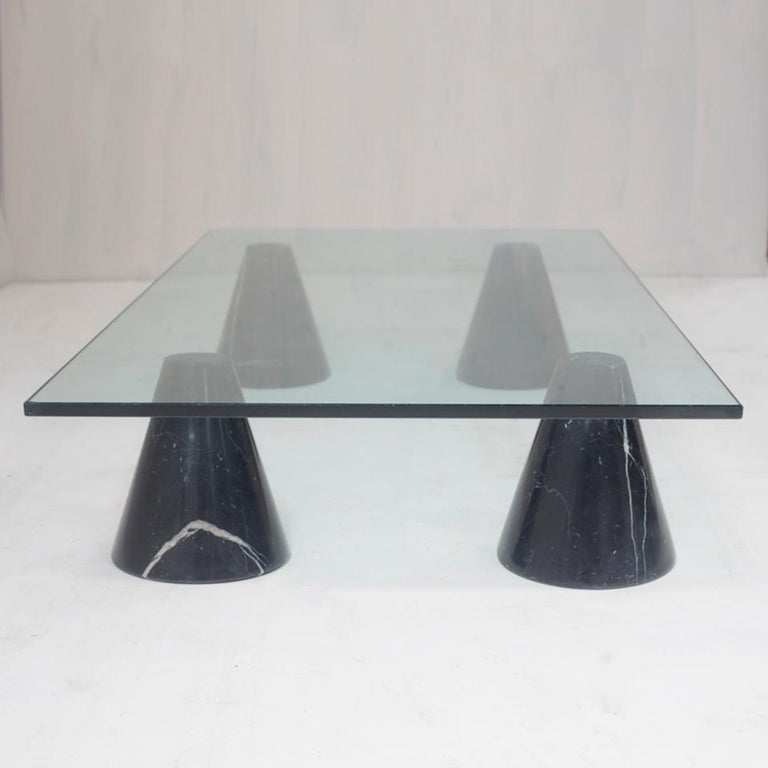 Glass top coffee table with cone-shaped black marble legs from Italy. The top and legs are not glued-on. Simple design.