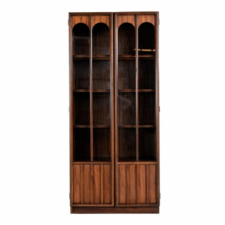 Two available and sold separately. This handsome Mid-Century Modern hutch features a glass display area and covered storage. Exhibit your collectibles or fine china in the lighted glass shelves. Figurines, glass, crystal and china will look amazing