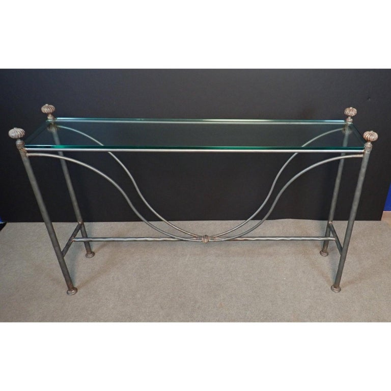Mid-Century Gun Metal Patina Modern Glass Top Iron Console Table. Glass top wrought iron console table. Elegant design and tailored narrow lines.