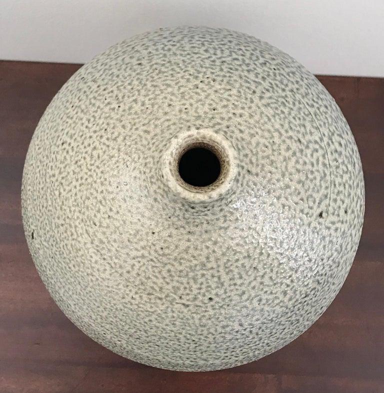 Beautiful earth tone glazed ceramic vase by American artist Michael Kreisberg, late 20th century.