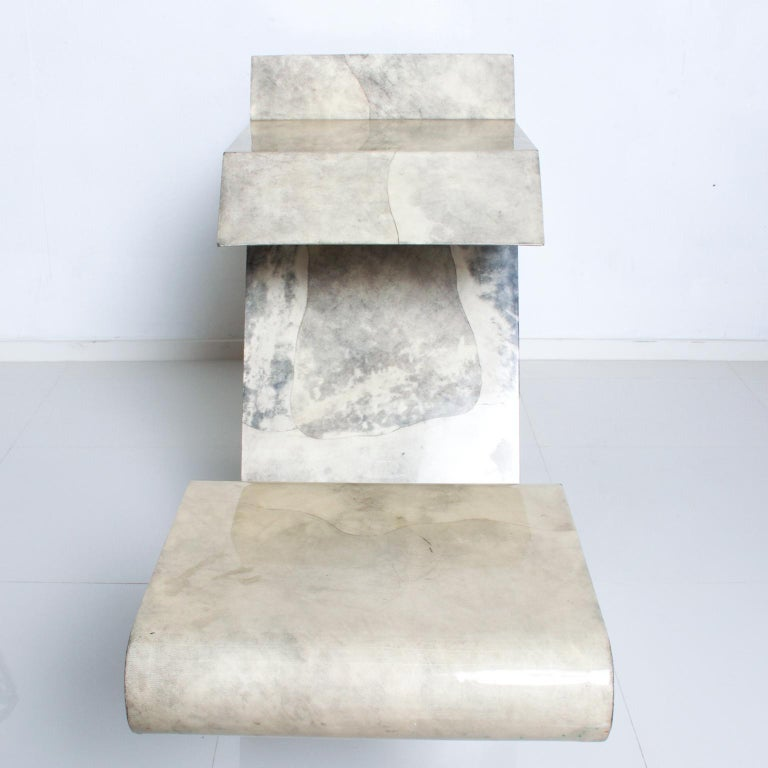 We are pleased to offer for your consideration, a fantastic console table. Geometric angle construction in wood, wrapped in goatskin parchment with light gray/natural tones and finished with resin. No markings or signature present from the maker.