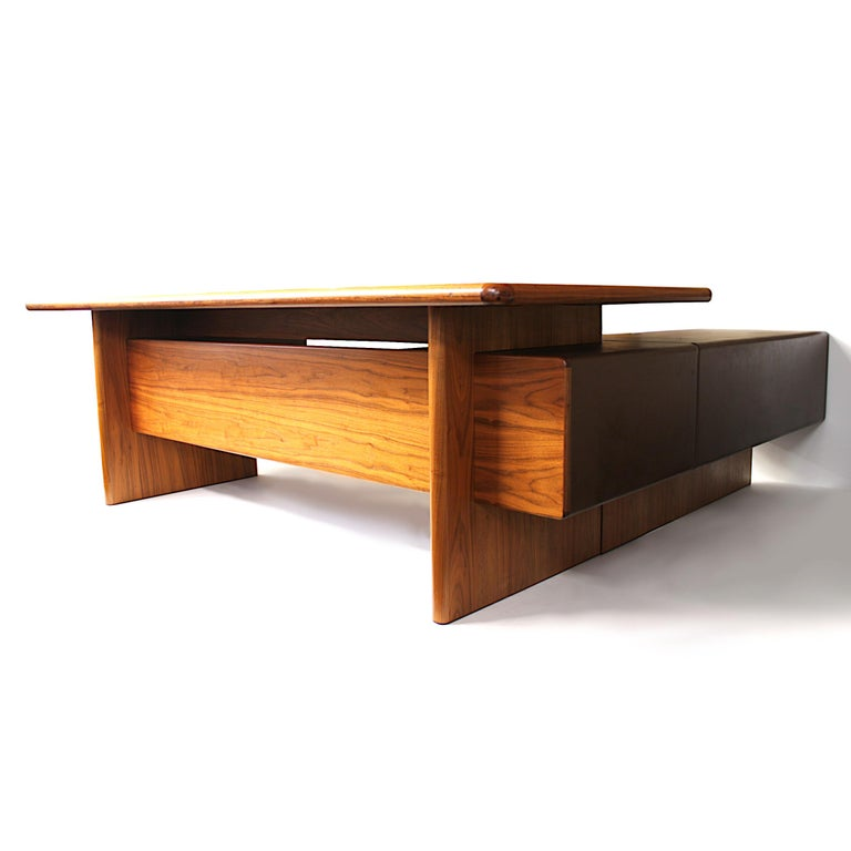 Spectacular 1970s vintage model GR90 executive desk designed by Ray Leigh for the English Furniture manufacturer Gordon Russell. Desk features the extremely rare return cabinet that gives this desk an impressive over-all scale and commanding