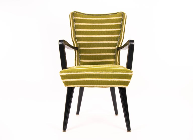 Armchair of French style first half of the XX century. Solid wood structure and turned legs lacquered in black. Original upholstery in green wool with raw stripes and yellow details. French vintage style.  Measurements: Width 57 cm Depth