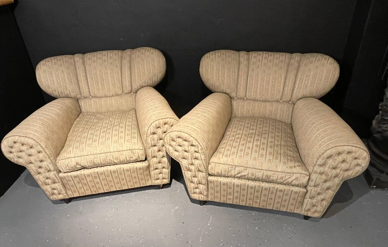 Italian Guglielmo Ulrich style lounge chairs a pair. Italy 1940s. Upholstery with painted wood. Unsigned.  Moderate stains, tears, and degradation of original upholstery. Sleek and stylish are these oversized pair of lounge chairs with tufted
