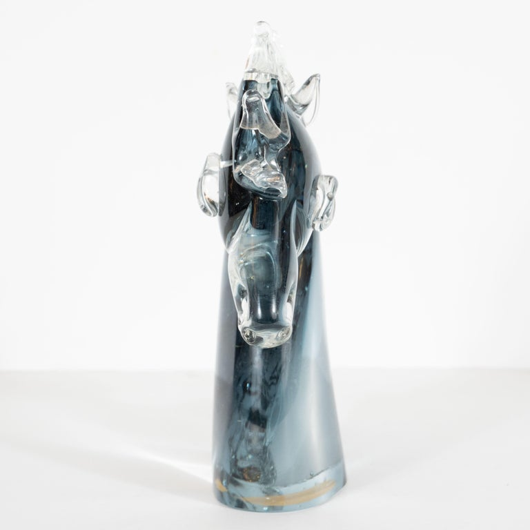 This graphic and refined Mid-Century Modern decorative object was hand blown in Milan, Italy circa 1960. It features a stylized stallion's head with ovoid eyes, articulated features and a highly sculptural main consisting of nine peaked forms all