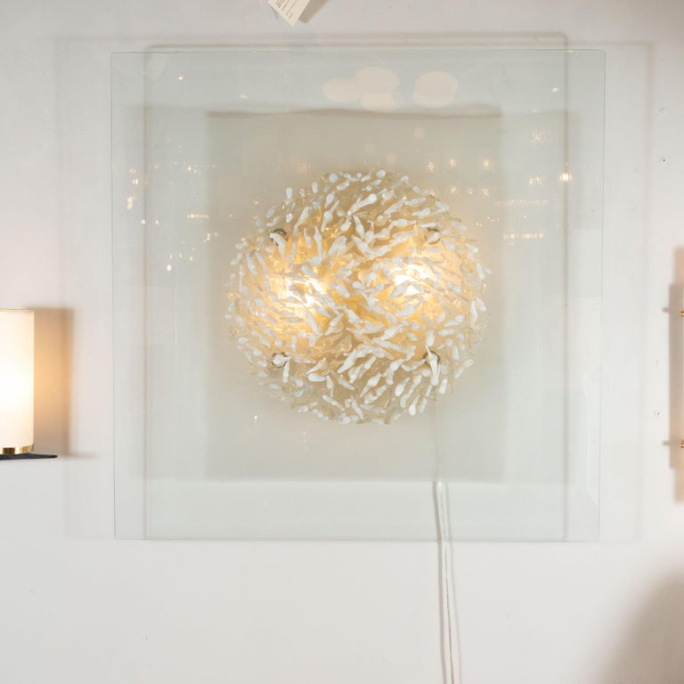This dynamic and sophisticated wall sculpture was designed and hand blown in Murano, Italy by the esteemed atelier of Angelo Brotto in 1972. It features an abundance of protuberant coral-like forms- in alternating white, translucent and opalescent