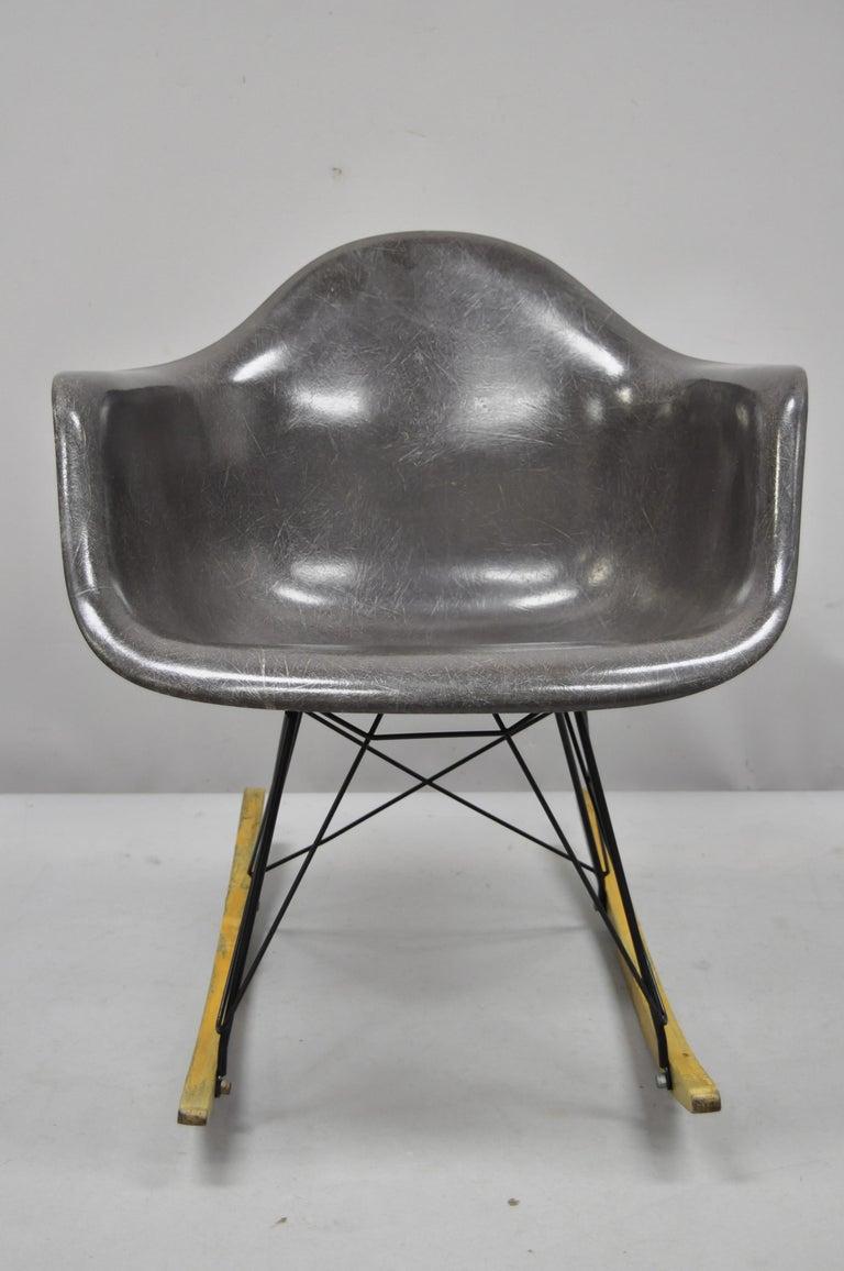 Vintage Mid-Century Modern Herman Miller Eames black fiberglass RAR rocking chair. Item features black fiberglass shell, original Herman Miller stamp to underside, very nice vintage item, circa mid-20th century. Measurements: 27