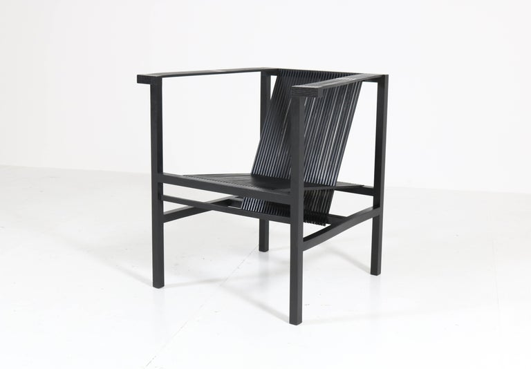 Stunning and rare Mid-Century Modern high slat armchair. Design by Ruud-Jan Kokke for Metaform, 1984 Striking Dutch design from the 1980s. Black lacquered beech frame and the linear nature of this design gives the impression of a relatively