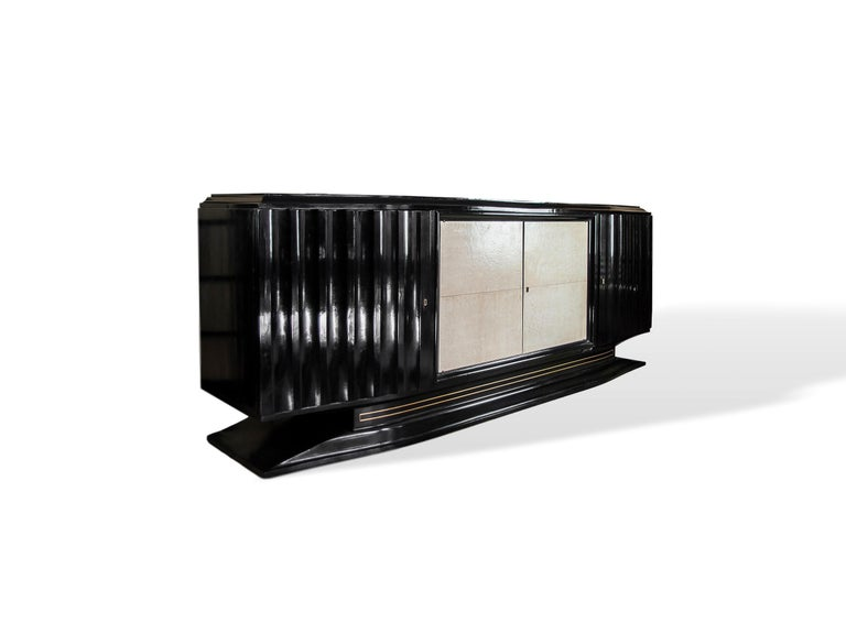 Mid-Century Modern Hollywood Regency Art Deco black lacquered and vellum sideboard, French, circa 1940, with inlaid bronze stringing, on a floating base.