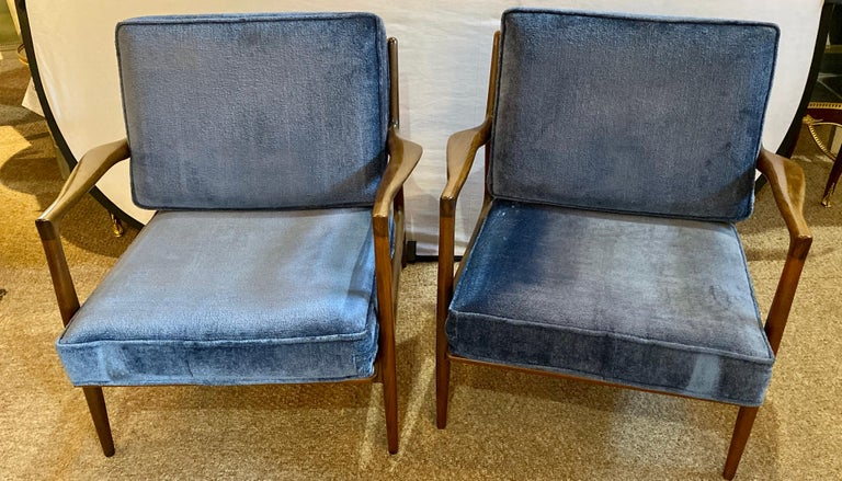 Mid-Century Modern Ib Kofod Larson Selig arm lounge chairs. A pair with Danish control label on each. The pair having overstuffed blue cushions on sleek slender and fine conditioned frames. 1SSX
