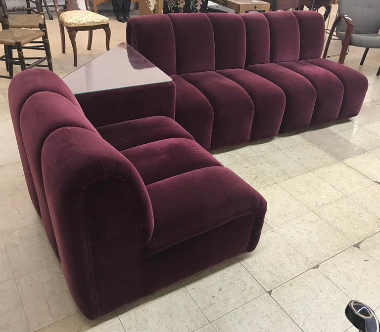 Stunning modular four piece sectional sofa, circa 1972 Italy. Fabric is special, a luxurious velvet burgundy.