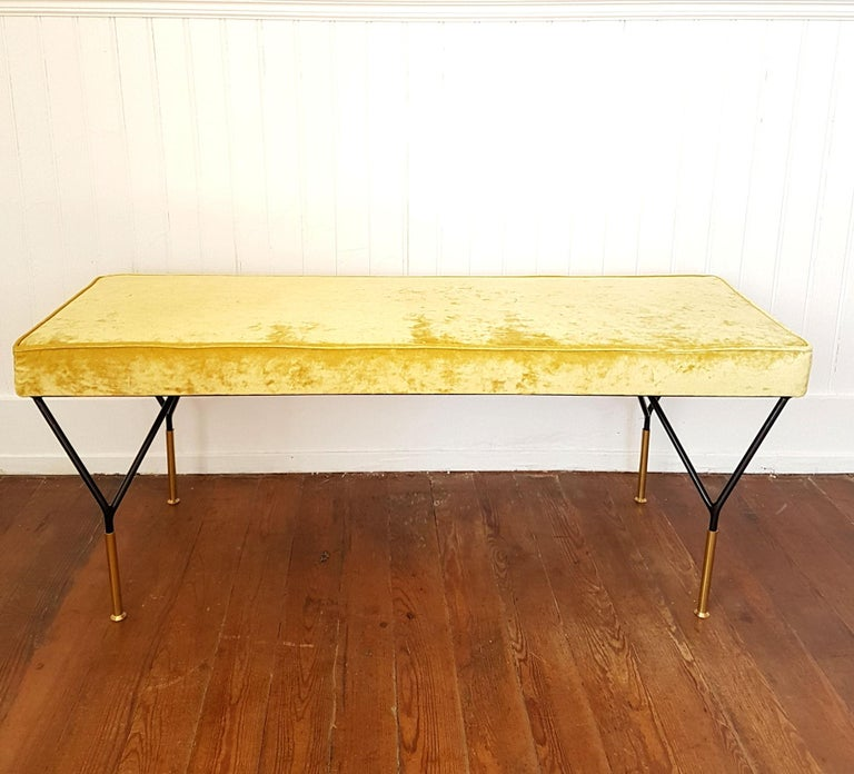 Mid-Century Modern Italian bench, newly upholstered with a yellow velvet. Legs are in black iron with brass endings. Italian midcentury style, Italy, 1980s.