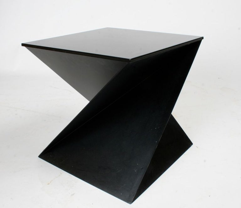 Mid-Century Modern sculptural metal cubist side table with removable top, made in Italy. Currently being repainted black. Pair available.