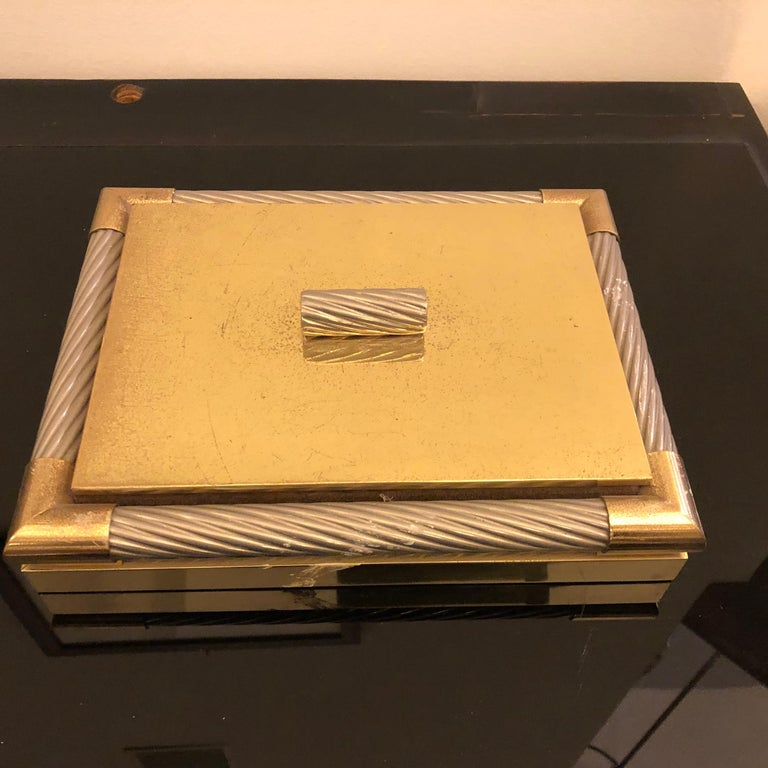 It's a Willy Rizzo style rectangular jewelry box, made in Italy in the 1970s, it's in original patina that create a vibrant vintage look.
