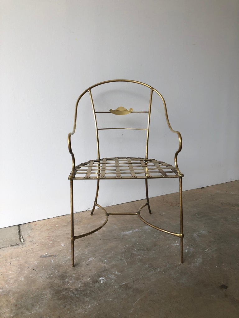 Offered is a Mid-Century Modern Italian brass decorative armchair. This would appear to be an original handmade artist's piece with a short or no run on the original. The seat is designed with a cross-hatch / basket weave of the brass and the frame